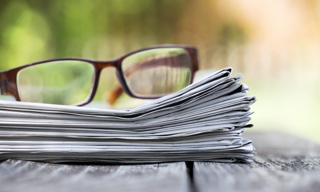 Morning news concept - newspaper and glasses