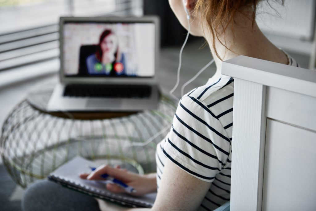 Rear view of woman having a video conference